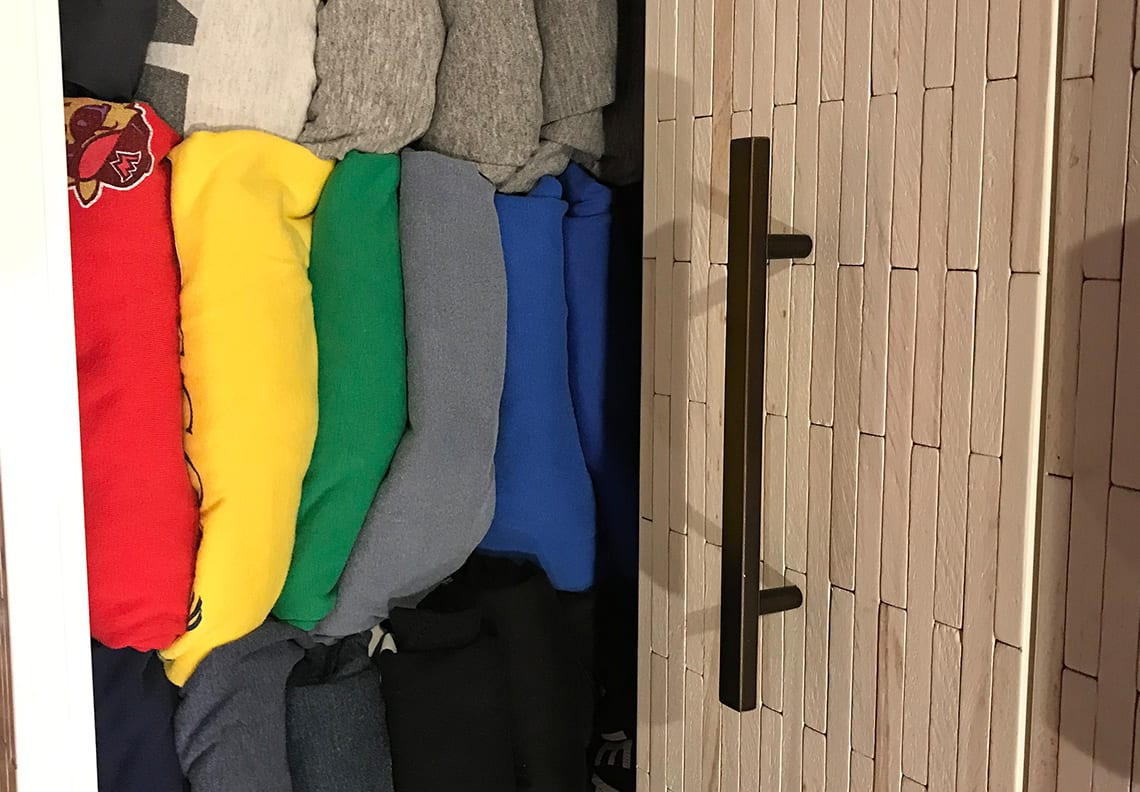 clothes stacked and organized neatly in an open closet