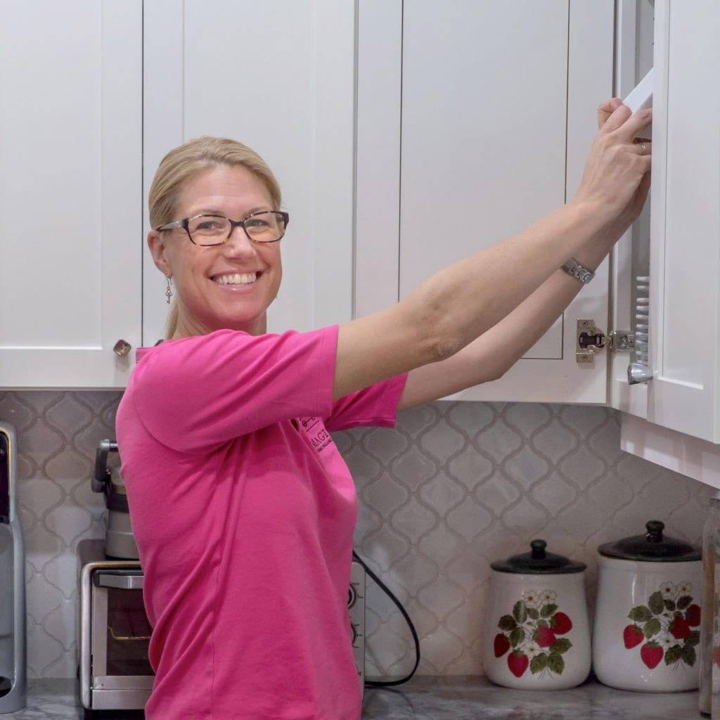 Kirsten Fisher organizing new home kitchen